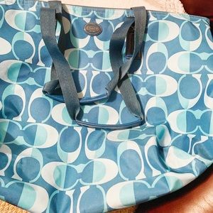Teal Coach Nylon Weekender Tote with cosmetic bag